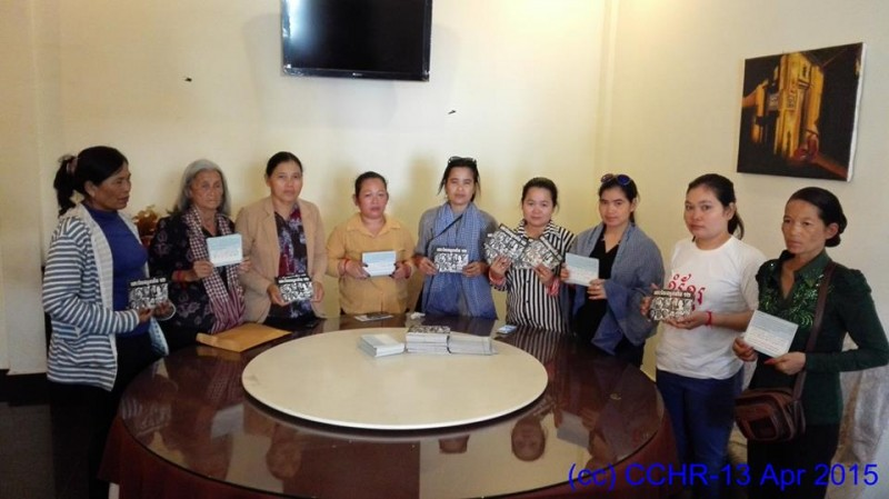 Holding the postcards sent to the detainees.