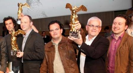Gabriel Jaime Vanegas Montoya and Alvaro Ramirez lifts the Ars Electronica Prize