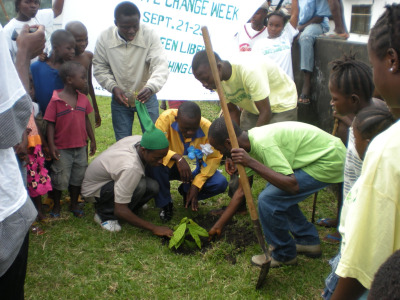 Planting a tree at Wood Camp Youth Versus Climate Change event. Photo courtesy of Saki Golafale
