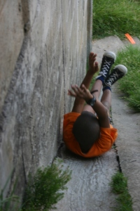 Using a drain near a cliff as a slide. Image by Henry El Sulcio