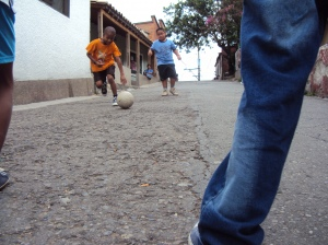 The street is their soccer field. Image by Henry El Sulcio