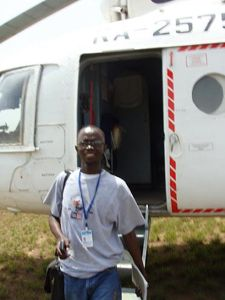 Nat Bayjay, Ceasefire Liberia's Blog Manager disembarking UN helicopter in  Voinjama