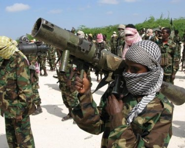 Teenage Al-Shabaab Soldiers in Training in Mogadishu, 2010. Al-Shabaab (Arabic - 'The Youth') call young children and teenagers from the countryside using the Propaganda department of the Executive Council of Al-Shabaab. They who reject face the death penalty.