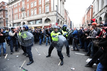 London, United Kingdom. 26th March 2011 -- photos of police in riot gear clashing with protesters at anti-cuts protest