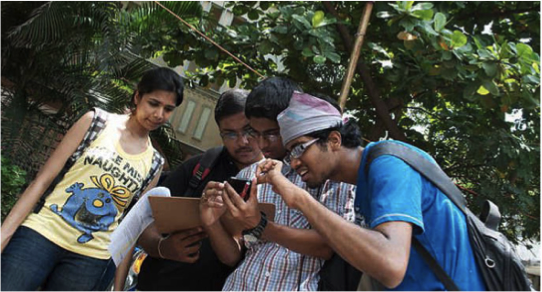 Student volunteers taking part in a Transparent Chennai community mapping.