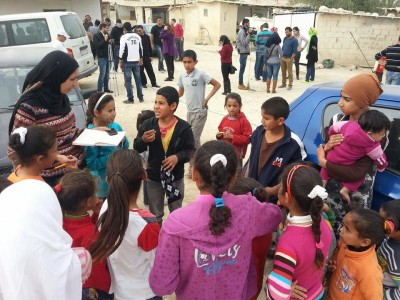 "One ""Blog Bus"" participant talks with a group of children in Jordan Valley. She hears about their daily life, problems, and dreams."
