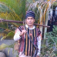 Portrait of Sok Socheat, Bunong language activist.