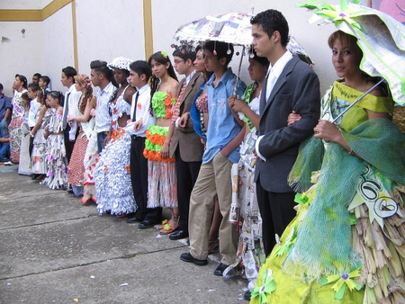 Pageant participants wearing dresses made with recycled materials
